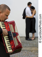 Sad Songs - A street musician playing his accordion ...