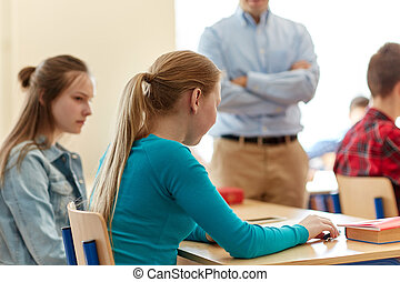 sad student girl with test result and teacher