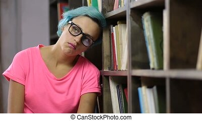 Sad student under mental pressure in library