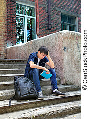 Sad Student with the Book outdoor