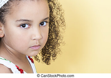 Sad Sulking Girl Child - A beautiful mixed race African...