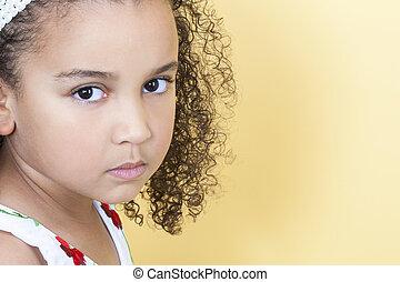 Sad Sulking Girl Child - A beautiful mixed race African...