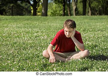 Sad Teen Looking Down