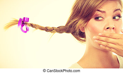 8743c0c0db Braid in mouth. Portrait of a funny blonde girl in big round ...