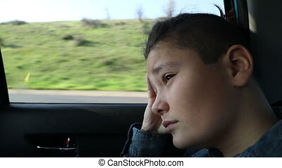 Sad teenage in the car