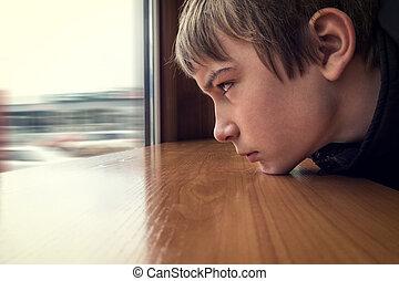 Sad Teenager look at Window - Toned Photo of Sad Teenager...
