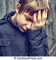 Sad Teenager outdoor - Toned Photo of Sad Kid on the Woooden...