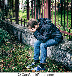 Sad Teenager outdoor - Toned Photo of Sorrowful Teenager sit...