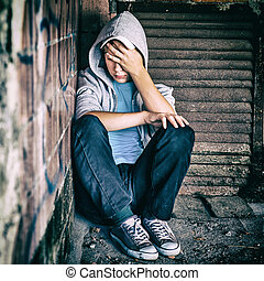 Sad Teenager outdoor - Toned Photo of Sad Teenager sit in...