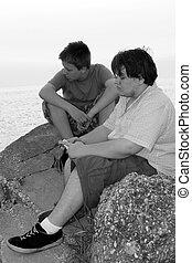Sad Teens 2 - Black and white portrait of two sad teenage...