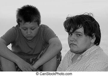 Sad Teens - Black and white portrait of two sad teenage...