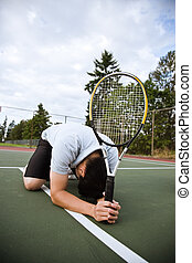 Sad tennis player after defeat - A sad asian tennis player...