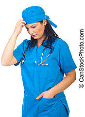 Sad thinker surgeon woman