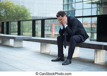 Sad thoughtful businessman portrait because of big problem