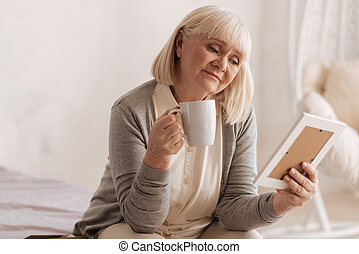 Sad thoughtful woman holding a cup of tea