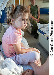 Sad three year old girl in the car with reserved seats