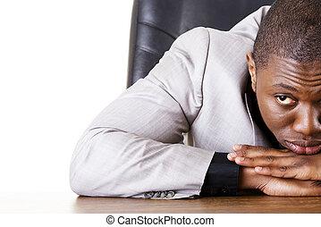 Sad, tired or depressed businessman at the desk.