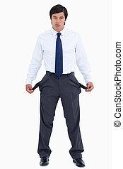 Sad tradesman showing his empty pockets