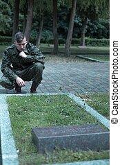 Sad uniformed soldier
