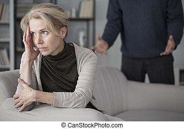 Sad wife looking ahead