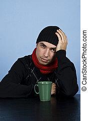 Sad winter man at table