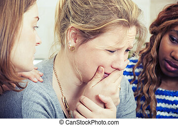 Sad woman being comforted by friend