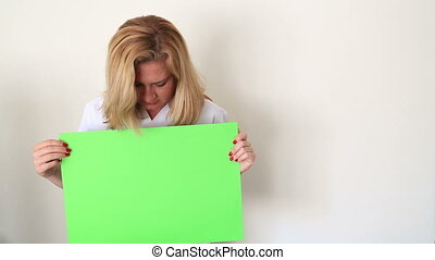 Sad Woman Holding Onto A Green Scre