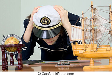 Sad woman in a sea uniform at table