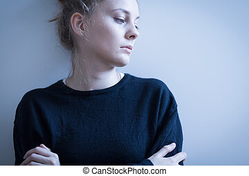Sad woman in black sweater