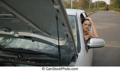 Sad Woman in broken car