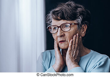Sad woman in glasses