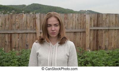Sad woman in the garden