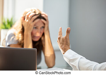 Sad Woman Looking At Her Colleague