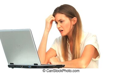 Sad woman looking at her laptop