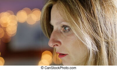 sad woman looking into the camera - sad despaired woman...