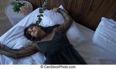 Sad woman lying with flower
