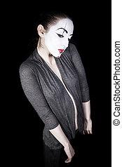 Sad woman mime on black background