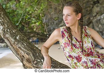 sad woman on tree