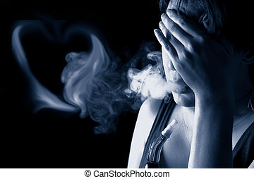 Portrait of sad woman smoking in the darkness