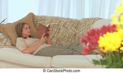 Sad woman reading a book
