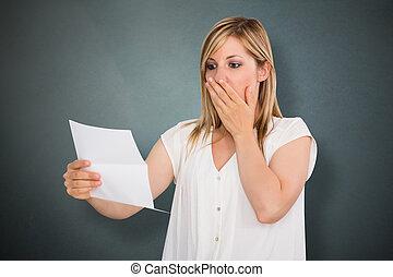 Sad Woman Reading Letter