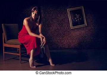 Sad woman sitting alone in a room