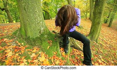Sad woman sitting in park.