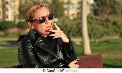 Sad woman sitting on a park bench