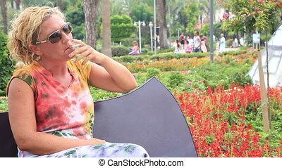 Sad woman smoking cigarette