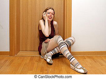 Terrified young woman sitting on the appartment floor after beaten up