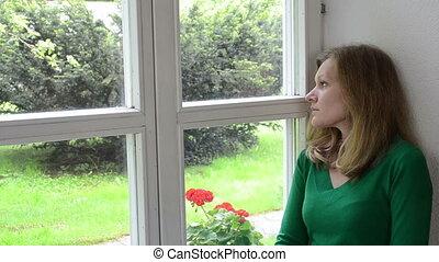 sad woman window sill