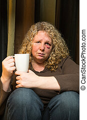 Sad woman with black eye - a middle aged woman with a black ...