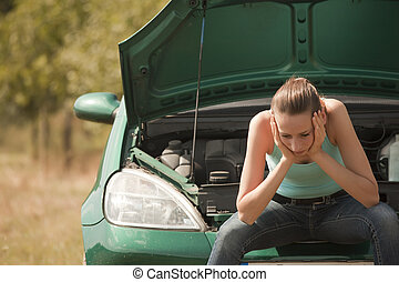 sad woman with broken car