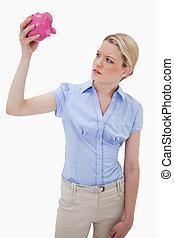 Sad woman with empty piggy bank